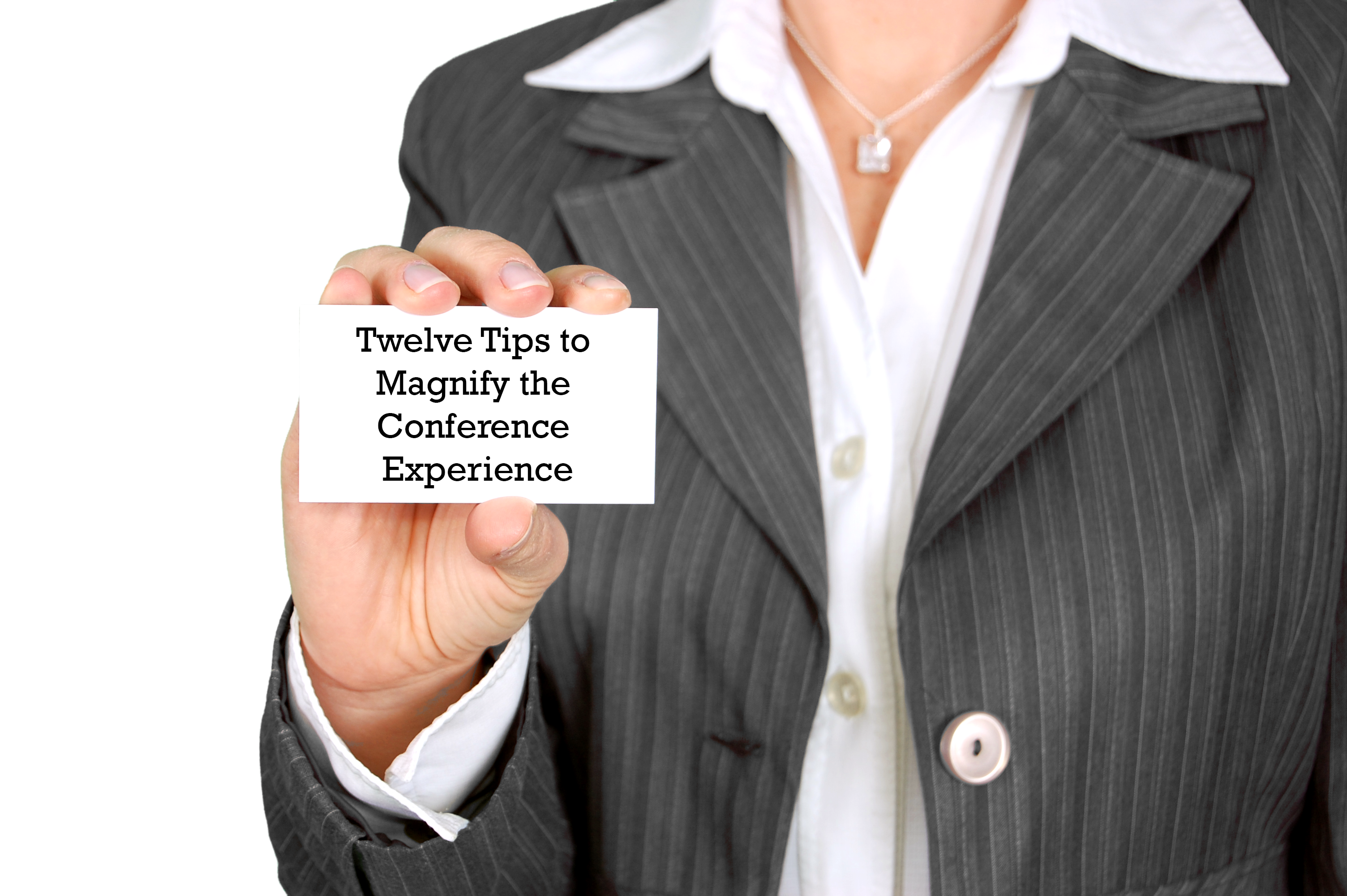 "Business woman holding a card that reads ""Twelve Tips to Magnify the Conference Experience."""