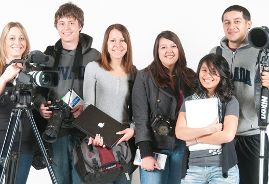 Students hold media equipment