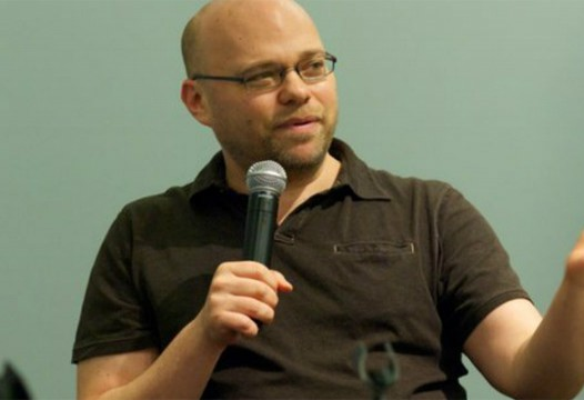 Adam Davidson speaks to students