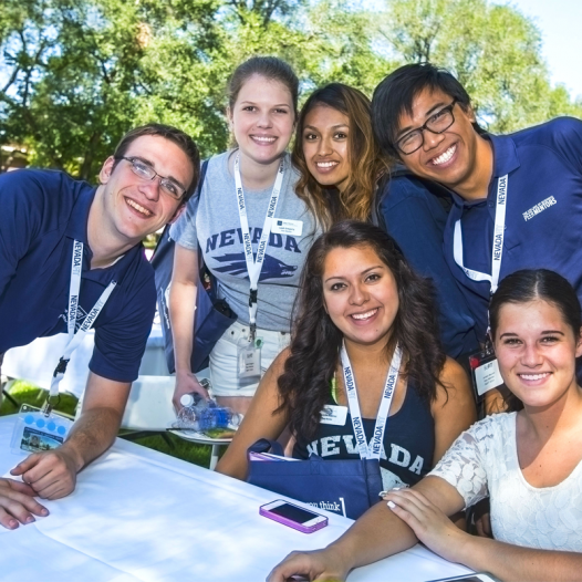 NevadaFIT students smiling in a sunny courtyard around a table