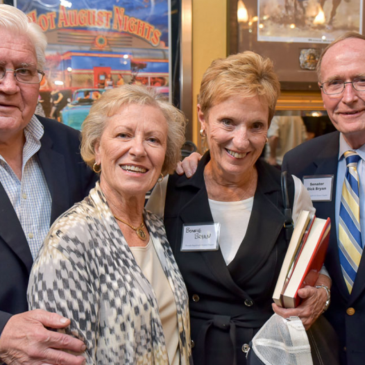 Left to right: Warren Lerude with his wife Janet and Senator Dick Bryan with his wife Bonnie at the Nevada Sagebrush Alumni Dinner. Photo by Mike Higdon.