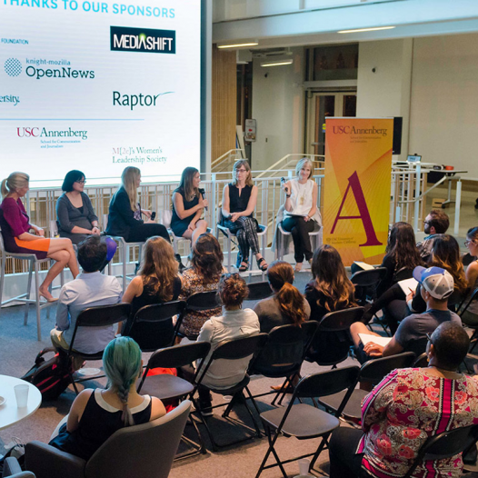 A panel of women presenting at the Women's Hackathon.