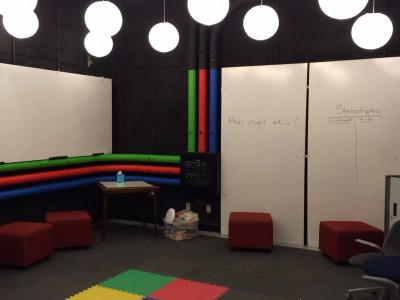 Innovation room, colored mats and white board walls