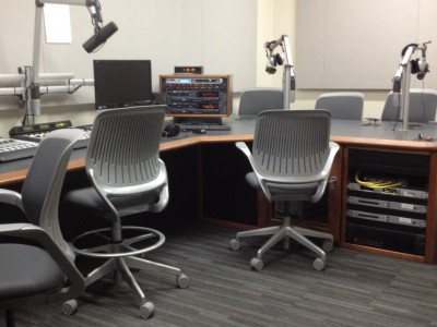 Radio production studio, chairs, computers and microphones