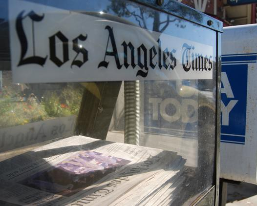 Los Angeles Times on a window and a USA newspaper box