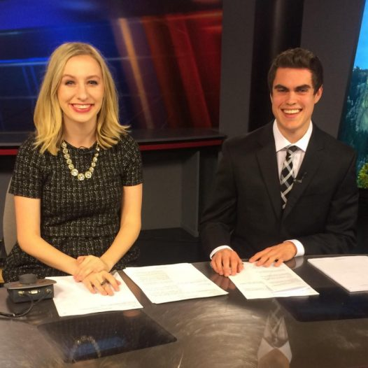 Heather Janssen sits with her co-anchor Robert Grant at the KEVN station in Rapid City, South Dakota.