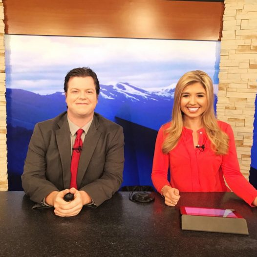 Conner Board sits on the anchor desk with her co-anchor at KPVI News Today.