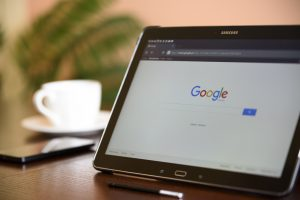 An open tablet with Google search open.
