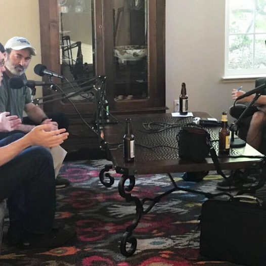 Joey Lovato sits with three others while working on a podcast.