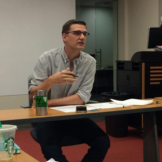 Professor Ben Birkinbine leads a discussion in one of his graduate courses.