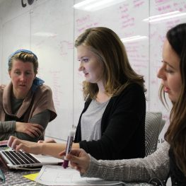 Katherine Hepworth mentoring students Nicole Tancredi from University of Nevada, Las Vegas and Kayla Robertson from University of Montana at a regional hackathon event in Feb. of 2017.