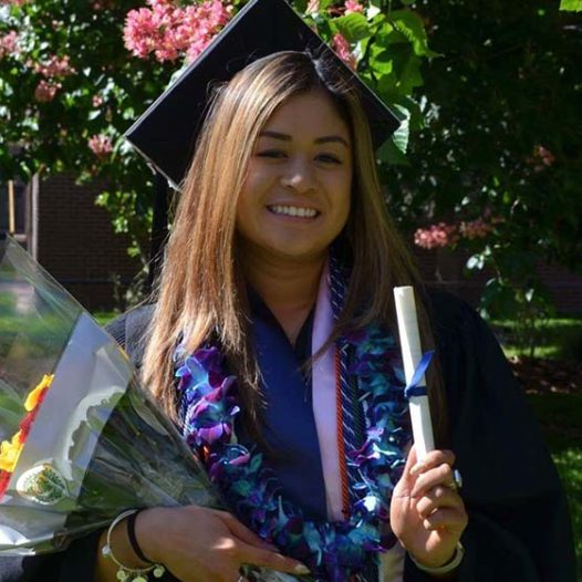 Melissa Ung poses in her cap and gown on her graduation day.