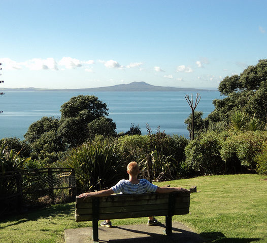student overlooks Bay in tropical location