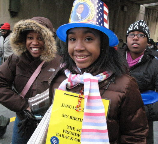 A woman in a patriotic hat poses on Inauguration Day 2009.