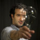 Jad Abumrad poses with a lightbulb.