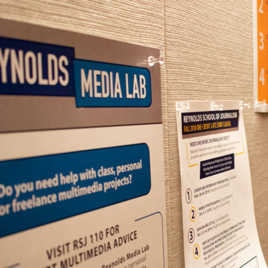 Posters on a bulletin board.