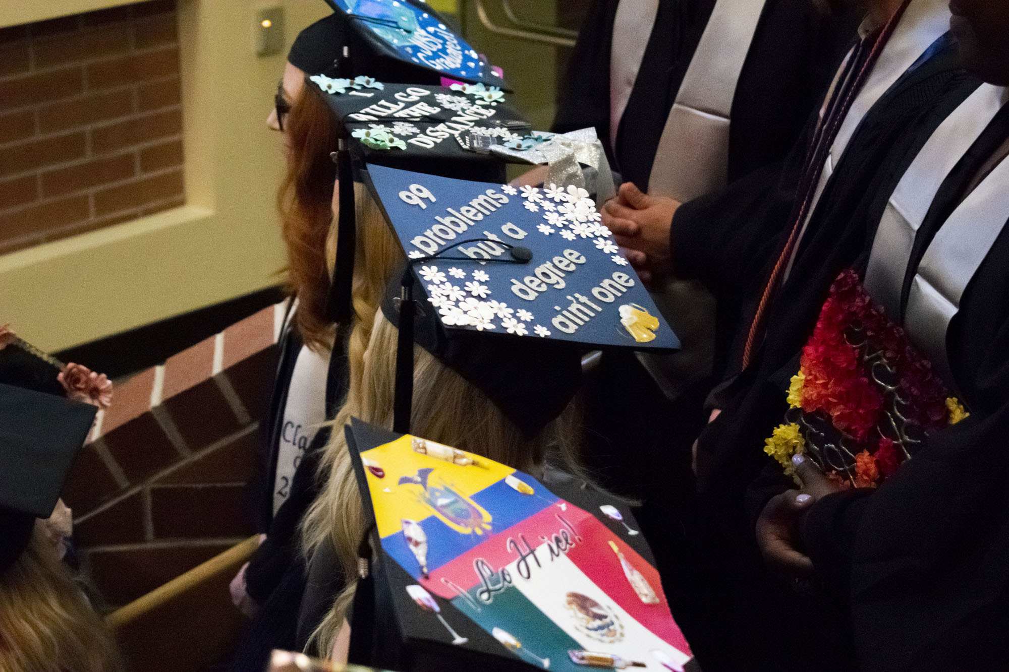A view from above of students' graduation caps.