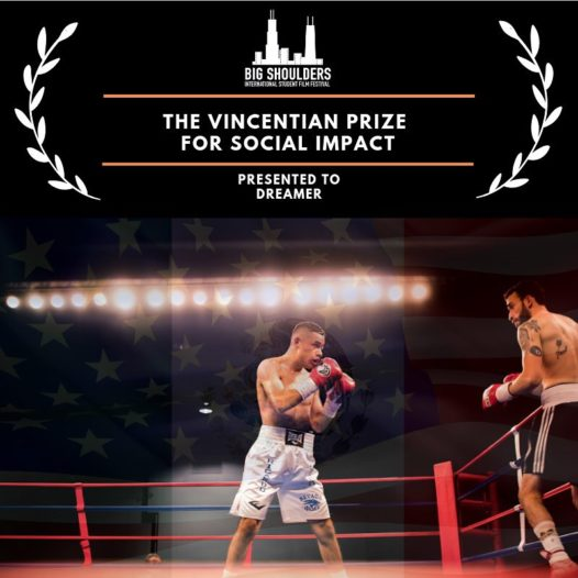 A boxer stands in a ring. Above him, an award graphic.